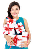 Beautiful girl with a gift boxes. Portrait of smiling young girl bring some gift boxes Stock Photos