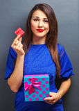 Beautiful girl with gift boxes Stock Image