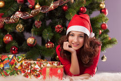 Beautiful girl with a gift Stock Images