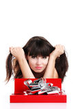 Beautiful girl with gift in red box with silver ribbon on white Stock Photo