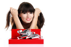 Beautiful girl with gift in red box with silver ribbon on white Royalty Free Stock Photos