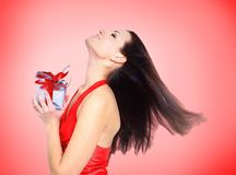Beautiful girl with gifts Stock Photography