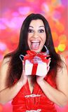 Beautiful girl with gifts Royalty Free Stock Images