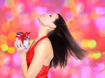 Beautiful girl with gifts. Stock Photo