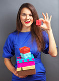 Beautiful girl with gifts Stock Image