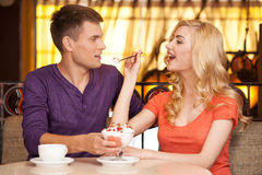 Beautiful girl giving ice-cream to man. Royalty Free Stock Photo