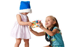 Beautiful girl giving out a present Stock Photography