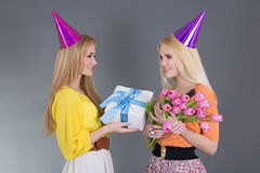 Beautiful girl giving a present to her friend Stock Photo