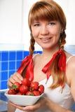 Beautiful girl giving strawberry. Royalty Free Stock Photo