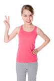 Beautiful Girl Giving Victory Sign Royalty Free Stock Photos