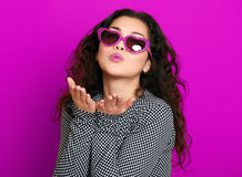 Beautiful girl glamour portrait on magenta make flying kiss Royalty Free Stock Photography