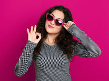 Beautiful girl glamour portrait on pink in heart shape sunglasses, long curly hair Stock Photos