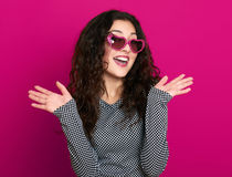Beautiful girl glamour portrait on pink in heart shape sunglasses, long curly hair Stock Images