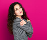 Beautiful girl glamour portrait on pink, long curly hair Royalty Free Stock Image