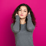 Beautiful girl glamour portrait on pink, long curly hair Stock Photo