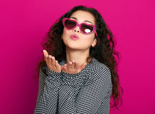 Beautiful girl glamour portrait on pink make flying kiss Stock Photo