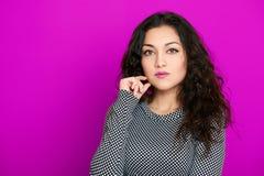 Beautiful girl glamour portrait on purple, long curly hair Stock Photo