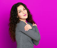 Beautiful girl glamour portrait on purple, long curly hair Royalty Free Stock Images