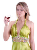 The beautiful girl with a glass. The girl with a glass in a green dress Stock Photos