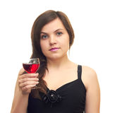 Beautiful girl with a glass. Beautiful girl in a black dress with a glass in hand isolated on white background Royalty Free Stock Images