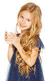 Beautiful girl with a glass of milk. Cute little girl with blond hair in a blue dress holding a glass of milk Stock Photography