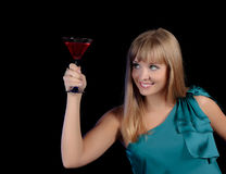 Beautiful girl with a glass of a red drink stock photos