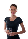 Beautiful girl with a glass of water in the hands Stock Images