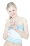 Beautiful girl with glass of water over white Royalty Free Stock Image