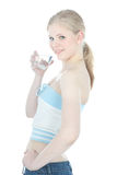 Beautiful girl with glass of water over white Royalty Free Stock Photos