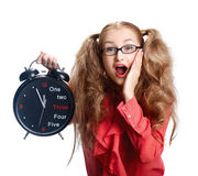 Beautiful girl in glasses with a big clock in panic Royalty Free Stock Photo