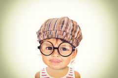 Beautiful girl with glasses and cap Royalty Free Stock Photography