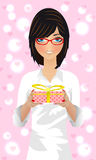 Beautiful girl in glasses with a gift on Valentine Royalty Free Stock Image