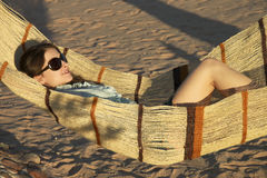 Beautiful girl in glasses is laying in hammock Stock Images