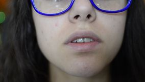 Beautiful girl with glasses Lips talk stock video
