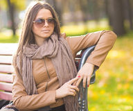 Beautiful girl with glasses in the Park Royalty Free Stock Image