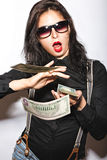 Beautiful girl in glasses with red lips and money in hands. Stock Photo