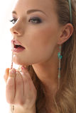 Girl lipstick on a white background Royalty Free Stock Photo
