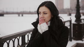 Beautiful girl goes over the bridge winter river stock footage