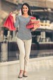 Beautiful girl going shopping Stock Photography