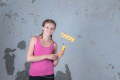 A beautiful girl is going to make repairs in the apartment and i royalty free stock photos