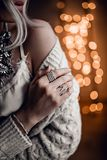 Gorgeous model on golden bokeh lights background Royalty Free Stock Photography