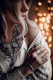 Portrait of beautiful model on golden bokeh lights background Royalty Free Stock Photo