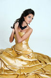 Beautiful girl in golden dress Royalty Free Stock Image