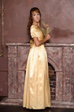 Beautiful girl in golden dress Royalty Free Stock Photo
