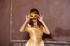Beautiful girl in golden dress Royalty Free Stock Photos
