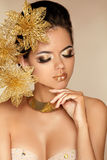 Beautiful Girl With Golden Flowers.   Stock Images