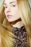 Beautiful girl with golden hair Stock Photos