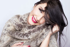 Beautiful girl. Gorgeous woman smiling in fur coat Royalty Free Stock Photography