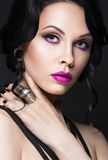Beautiful Girl in the Gothic style with leather Stock Images