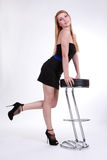 A beautiful girl in a graceful pose near the bar c Royalty Free Stock Photography
